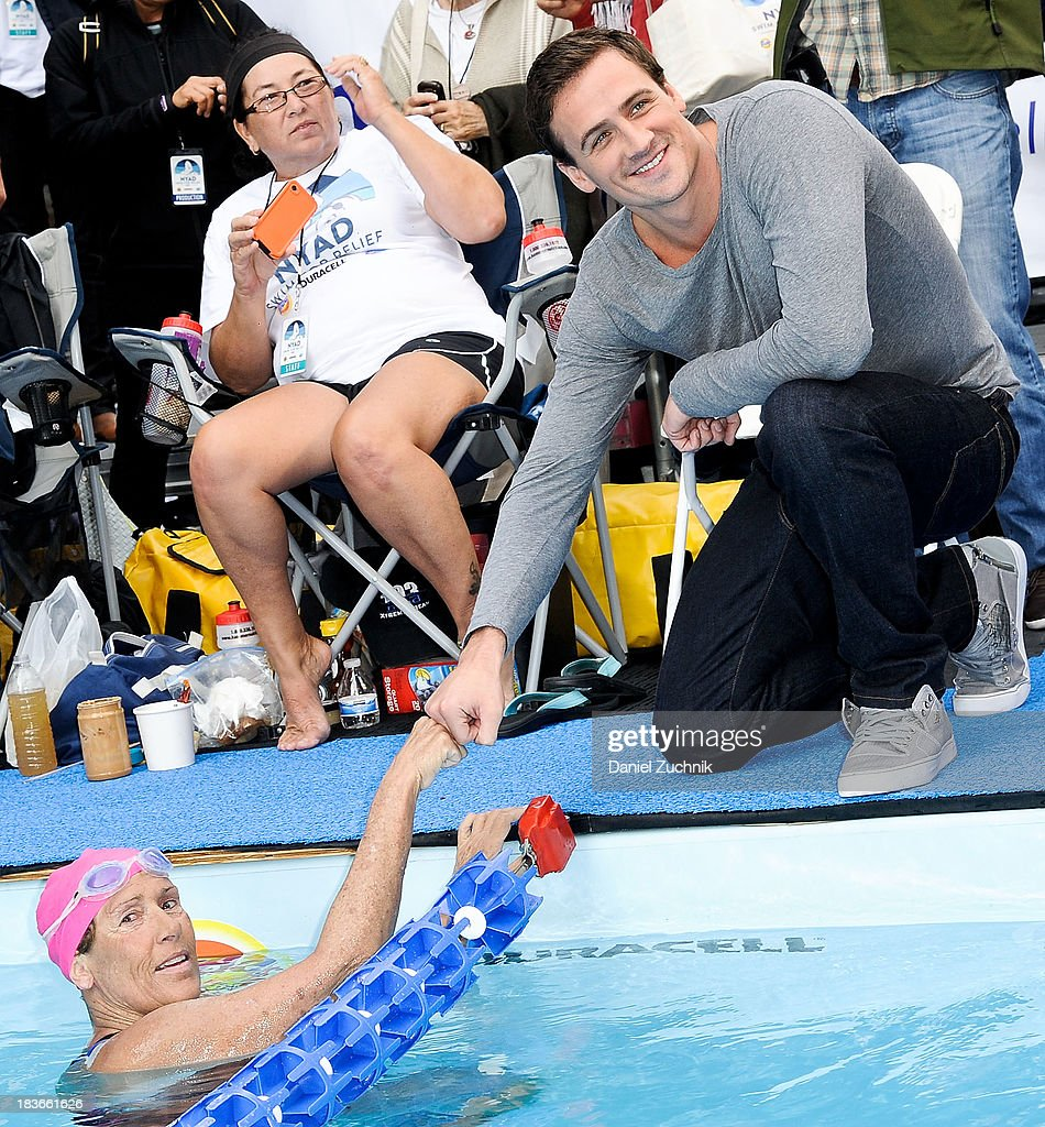 Diana Nyad and Olympic swimmer Ryan Lochte prepare to swim during the 'Swim for Relief' benefiting Hurricane Sandy Recovery at Herald Square on...