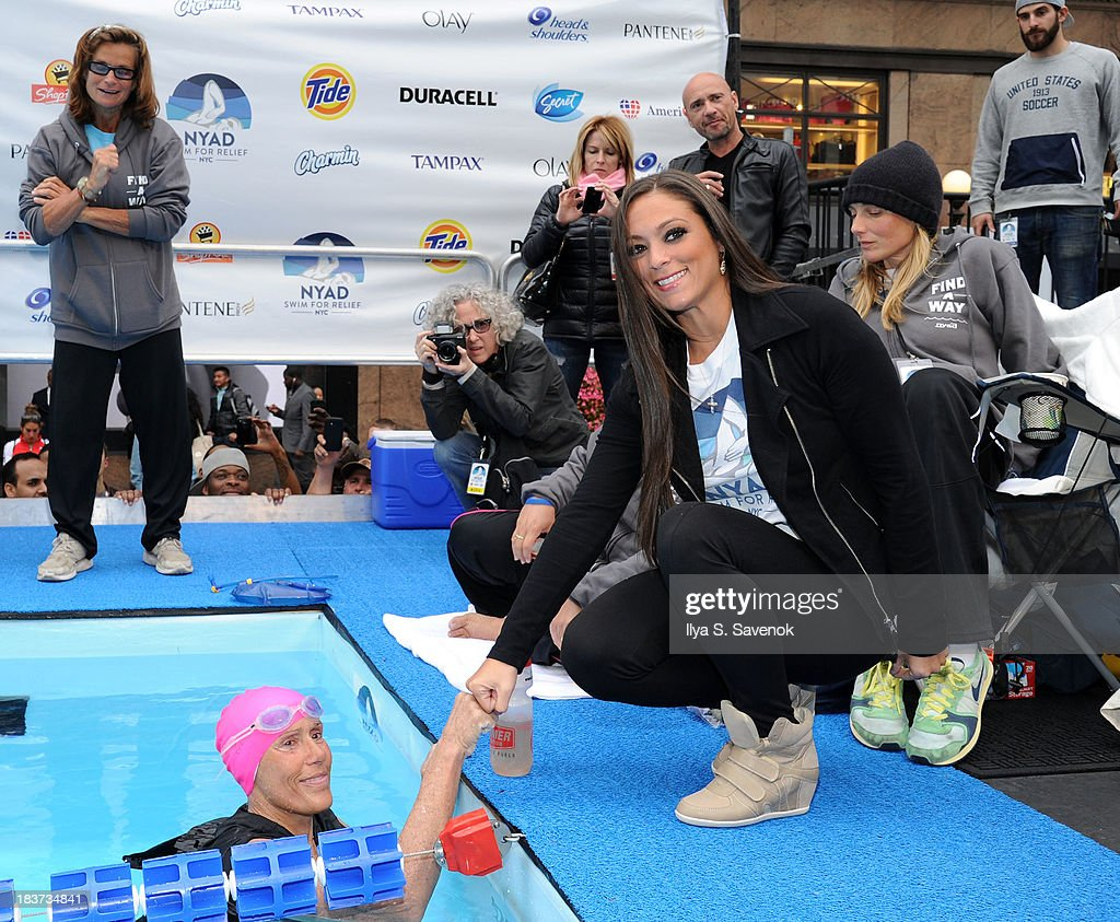<a gi-track='captionPersonalityLinkClicked' href=/galleries/search?phrase=Diana+Nyad&family=editorial&specificpeople=678501 ng-click='$event.stopPropagation()'>Diana Nyad</a> (L) and Sammi 'Sweetheart' Giancola pose during 'Swim for Relief' Benefiting Hurricane Sandy Recovery - Day 2 at Herald Square on October 9, 2013 in New York City.