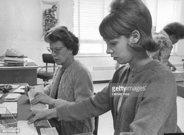 Diana Oliver Foreground Opens Mail and Checks Water Bills Behind her at Thornton Meter Department is her supervisor Mrs Grace Lindner Credit Denver...
