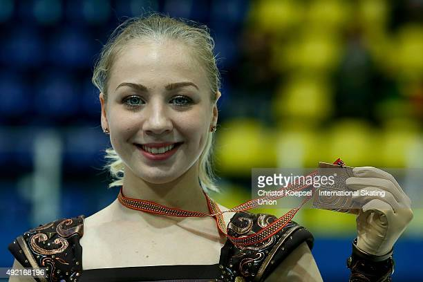 Diana Pervushkina of Russia presents her bronze medal during the medal ceremony of the junior ice short dance of the ISU Junior Grand Prix at Dom...