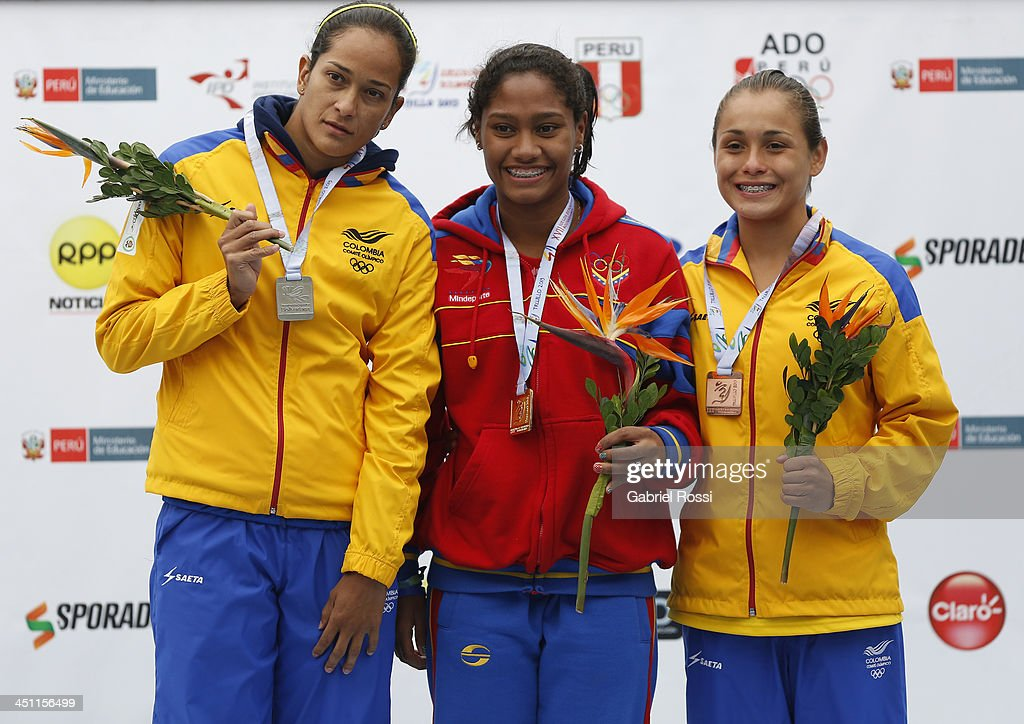 Diana Pineda of Colombia (silver medal), Maria Betancourt of Venezuela (gold medal) and Carolina Murillo of Colombia (bronce medal) pose for a photo after the diving event as part of the XVII Bolivarian Games Trujillo 2013 at Villa Regional del Callao on November 21, 2013 in Lima, Peru.