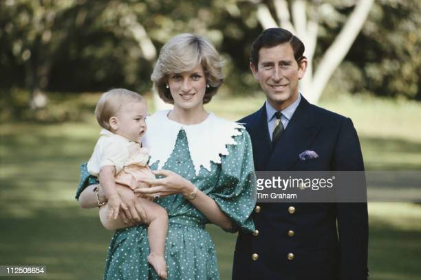 Diana Princess of Wales 19611997 holding Prince William and standing beside Prince Charles during a photocall at Government House in Auckland during...