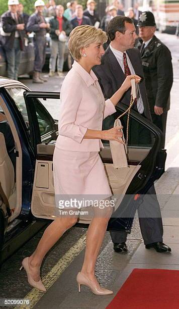 Diana Princess Of Wales Alighting Her Car On Arriving At The Savoy Hotel For The Daily Star Gold Awards The Princess Is Wearing A Pink Suit Designed...