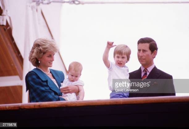 Diana Princess of Wales and Charles Prince of Wales hold Prince Harry and Prince William on the deck of the Royal Yacht Britannia during the Royal...