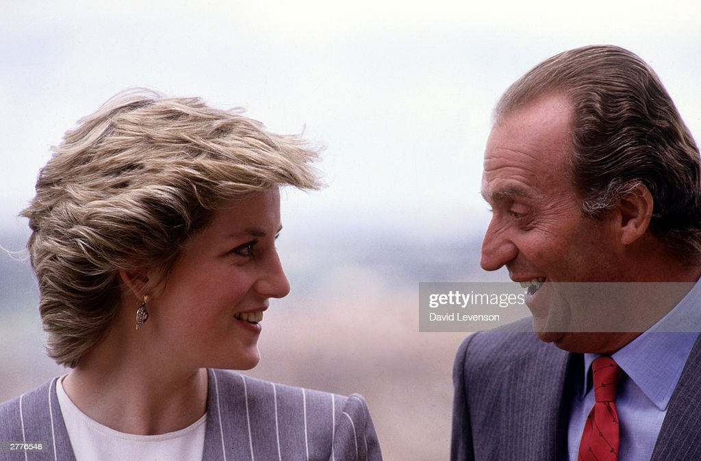 Diana Princess of Wales and King Juan Carlos of Spain talking during a visit on April 23, 1987 to Toledo, Spain. Diana wore an outfit designed by Catherine Walker.