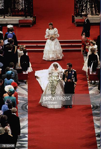 Diana Princess of Wales and Prince Charles Prince of Wales on their wedding day at St Paul's Cathedral Sarah ArmstrongJones is the bridesmaid behind...