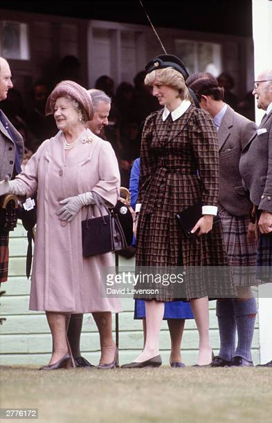 Diana Princess of Wales and the Queen Mother attend the Braemar Games on September 4 1982 at Braemar near Balmoral Scotland The Princess wore a dress...