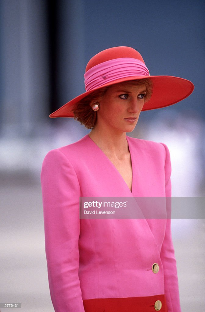 Diana Princess of Wales arrives in Dubai, United Arab Emirates, during the Royal Tour of the Gulf in March 1989. Diana wore a dress by Catherine Walker.