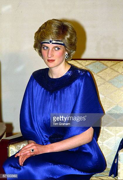 Diana Princess Of Wales At A Dinner Hosted By Emperor Hirohito In Japan She Is Wearing A Pleated Royal Blue Evening Dress Designed By Fashion...