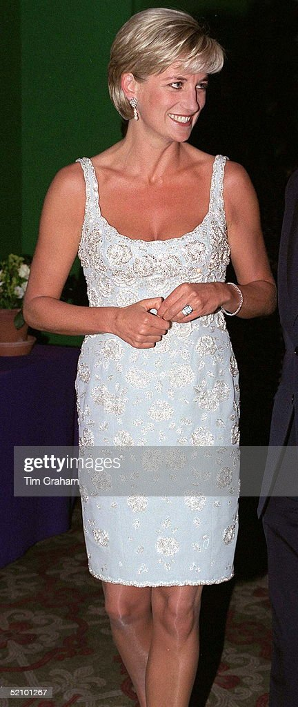 Diana, Princess Of Wales, At A Private Viewing And Reception At Christies In Aid Of The Aids Crisis Trust And The Royal Marsden Hospital Cancer Fund. The Princess Is Wearing A Low-cut Pale Blue Cocktail Dress Designed By Catherine Walker.