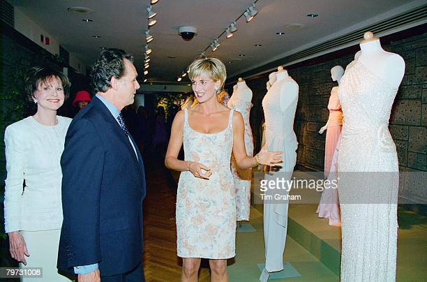 Diana Princess of Wales at Christies attending the gala party to launch the sale of her dresses She is with Lord Hindlip Chairman of Christies...