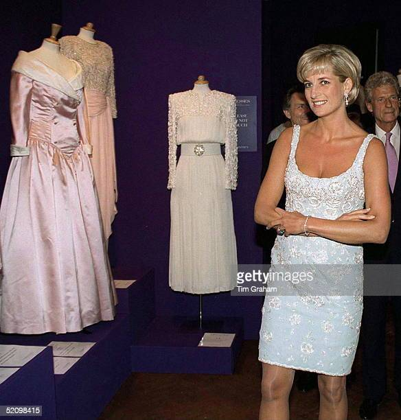Diana Princess Of Wales At The Christies Preauction Party In London Wearing A Dress By Catherine Walker And Looking At Dresses By The Same Designer...