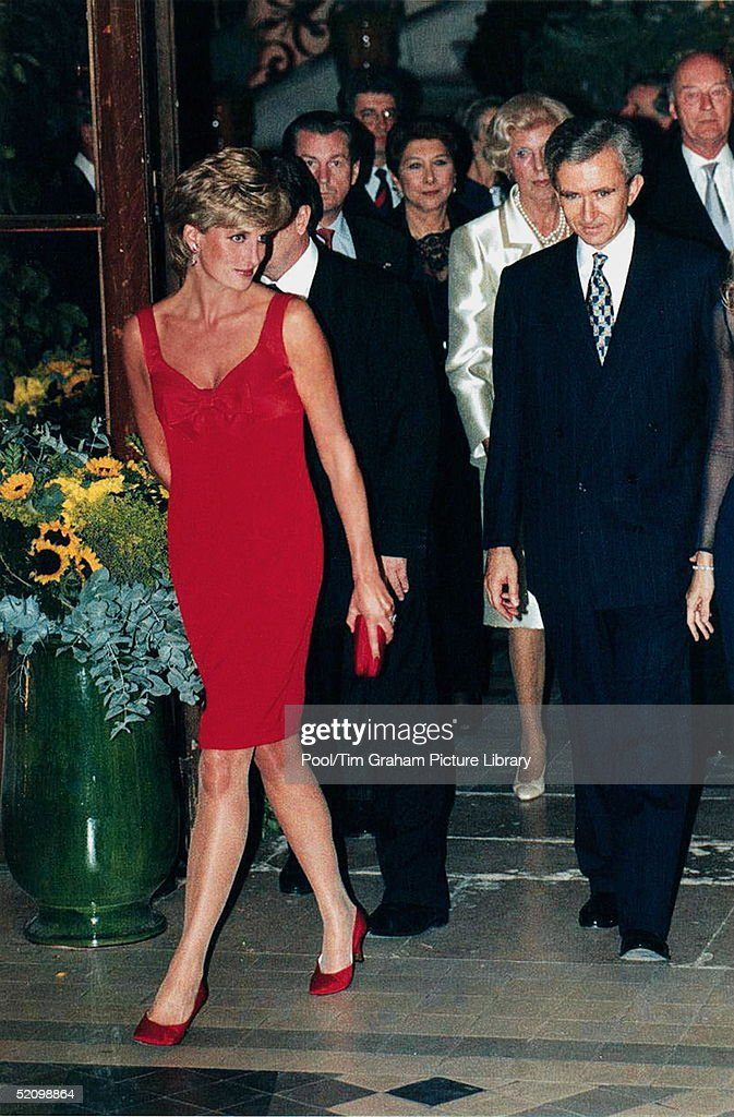Diana, Princess Of Wales Attending A Dinner In Aid Of The Great Ormond Street Hospital At The Foundation Claude Pompidou, Paris, France. The Princess Is Wearing A Red Cocktail Dress With Matching Red Shoes.