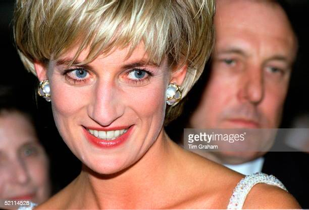Diana Princess Of Wales Attending The Christies Gala Party To Launch The Sale Of Her Dresses For Charity Behind Is Her Bodyguard Dave Sharp