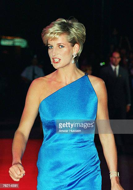 Diana Princess of Wales attends a benefit dinner in October 1996 in Sydney Australia The Princess is wearing a stunning turquoise silk dress caught...