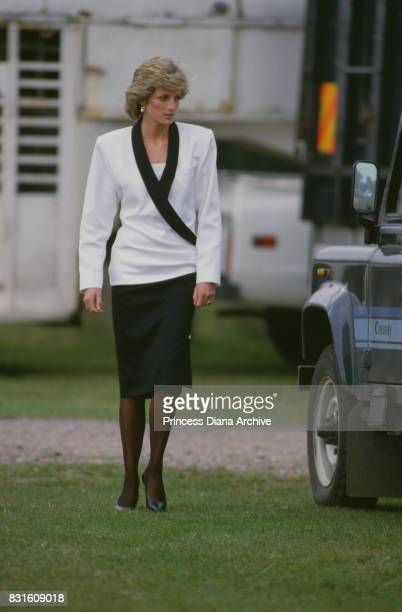 Diana Princess of Wales attends a Guards Polo Club match at Smiths Lawn Windsor 29th May 1985 The princess is wearing a black and white suit by...