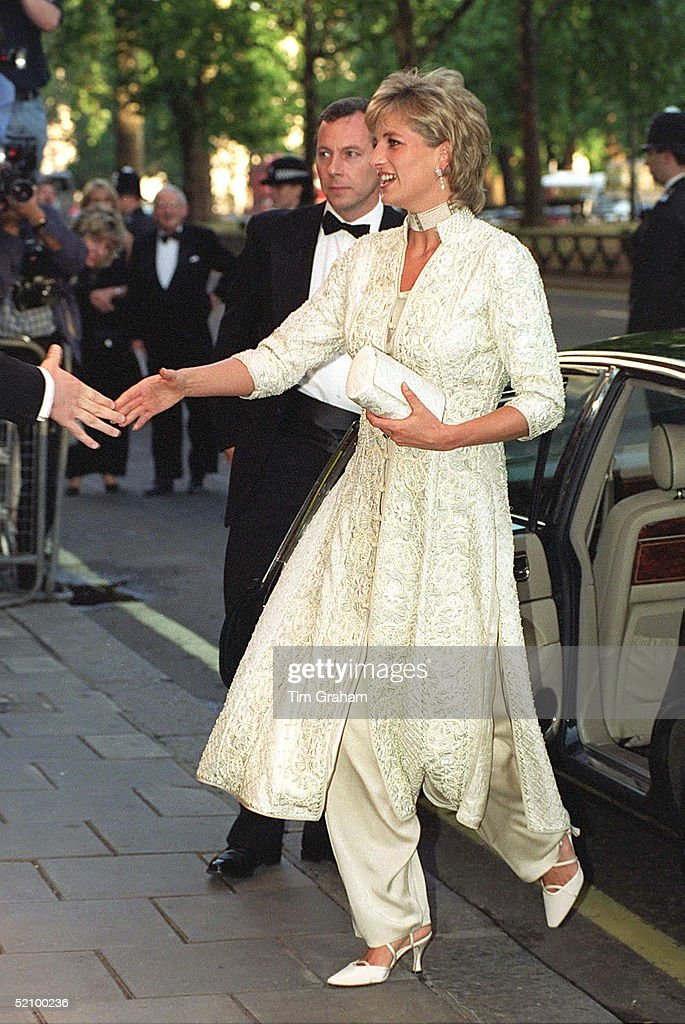 Diana, Princess Of Wales, Attends Dinner At London's Dorchester Hotel In Aid Of The Shaukat Khanum Memorial Hospital In Pakistan. The Princess Is Wearing A Beaded And Embroidered Ivory Couture Shalwar Kameez As A Tribute To Imran Khan Who Has Organised The Event.