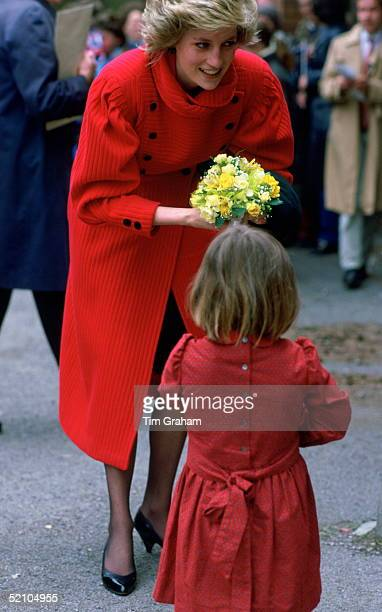 Diana Princess Of Wales Being Given A Bouquet Of Spring Flowers By A Little Girl During A Walkabout In Basingstoke Where She Presented Prizes For The...