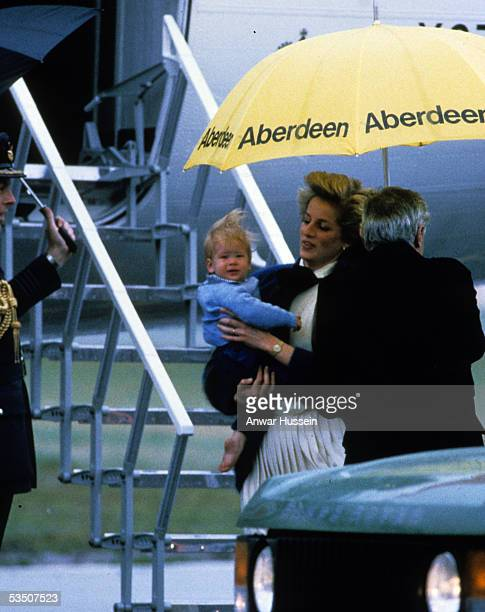 Diana Princess of Wales carries baby Prince Harry when they arrive at Aberdeen Airport on their way to Balmoral in September 1985 in Aberdeen Scotland