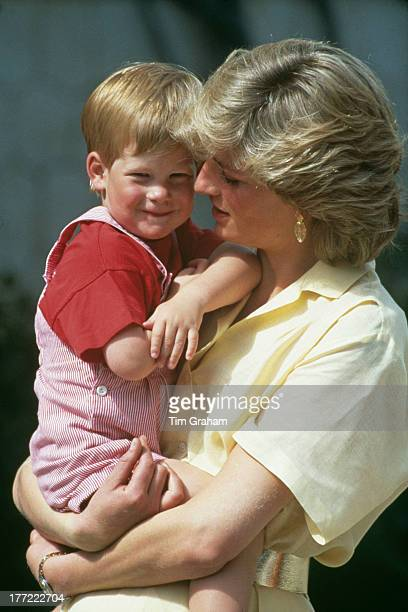 Diana Princess Of Wales carrying her son Prince Harry at a photocall during their summer holiday at the Spanish Royal Palace of La Almudaina just...