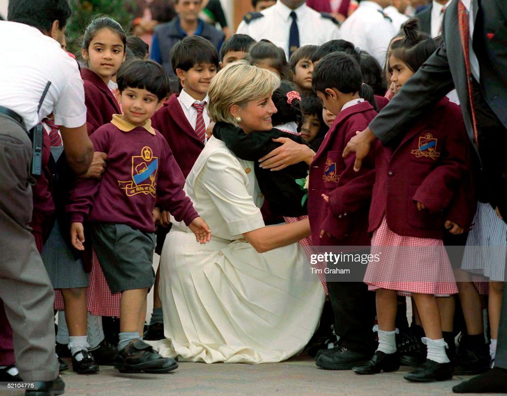 Diana Princess Of Wales Crouching Down To Embrace One Of The Many Pupils At The Swaminarayan School Whom She Met During Her Visit To The Shri Swaminarayan Mandir In Neasden,london