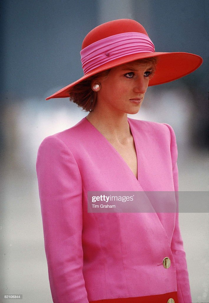 Diana, Princess Of Wales, During Her Official Tour Of Kuwait The Princess Is Wearing A Pink And Red Clashing Colours Coat Dress Designed By Catherine Walker With A Matching Hat By Philip Somerville.
