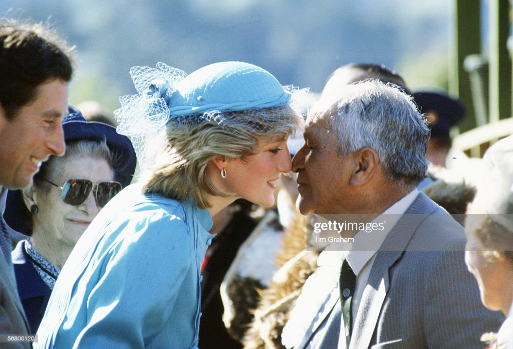 Diana Princess of Wales greets a Maori man with a traditional Hongi, rubbing of noses, during a walkabout in Wellington, New Zealand.
