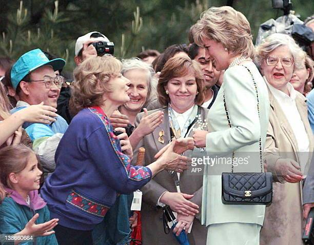 Diana Princess of Wales greets the crowd on a walking tour of the Northwestern University campus 04 June in Evanston Illinois Lady Diana will be...