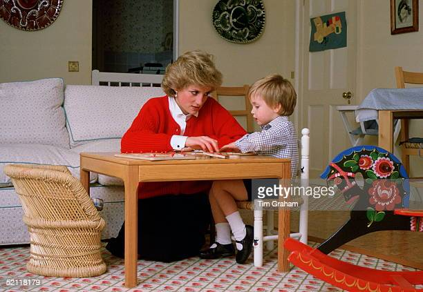Diana Princess Of Wales Helping Her Son Prince William With A Puzzle At Home In The Playroom Of Kensington Palace