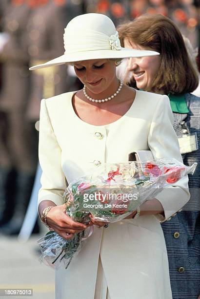 Diana Princess of Wales holds bouquets of flowers at the airport during the first day of her official visit to Hungary on May 8 1990 in Budapest...