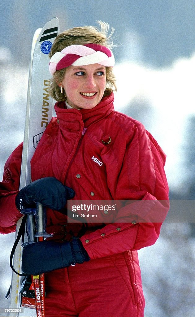 Diana Princess of Wales holds her skis and poles during a holiday in Klosters Switzerland wearing a skisuit by Head and a braided headband