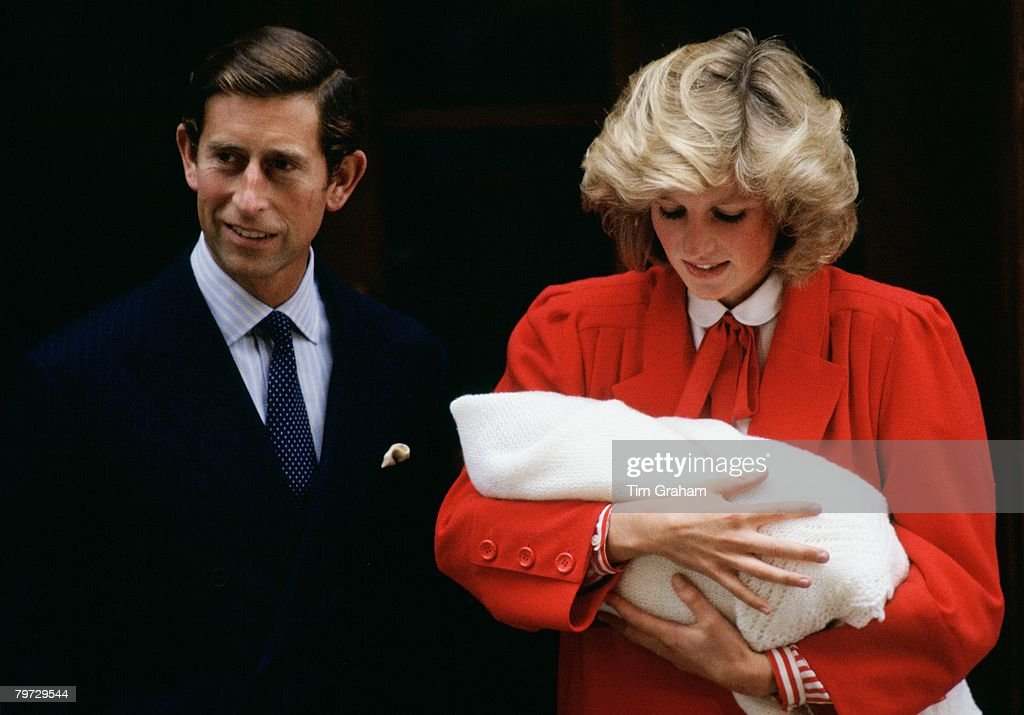 Diana, Princess of Wales holds Prince Harry as she and Prince Charles, Prince of Wales leave the Lindo Wing at St Mary's Hospital in Paddington