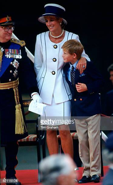 Diana Princess Of Wales Hugging Prince Harry As They Watch The Vj Day Parade In The Mall She Is Wearing A Suit By Fashion Designer Tomasz Starzewski...
