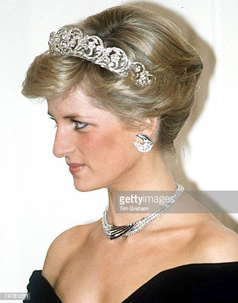 Diana Princess of Wales in Spencer family tiara with a suite of jewels a gift from the Sultan of Oman crescent shaped diamond and saphhire earrings...