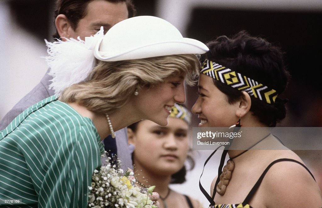 Diana Princess of Wales is given the traditional Maori greeting of a nose rub in the Eden Park Stadium, on her arrival on April 18, 1983 in Auckland, New Zealand, at the start of the Royal Tour of New Zealand. Princess Diana wore a dress designed by Donald Campbell, with a hat by John Boyd.