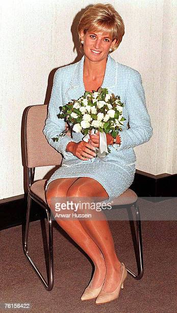 Diana Princess of Wales is presented with the first rose to be named after her at the British Lung Foundation offices on April 21 1997 in London...