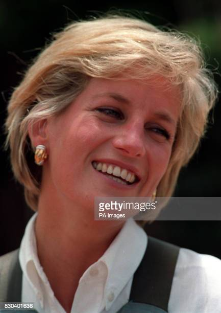 Diana Princess of Wales laughs during her visit to a minefield at Huambo in Angola The Princess pressed the trigger to detonate one of the landmines