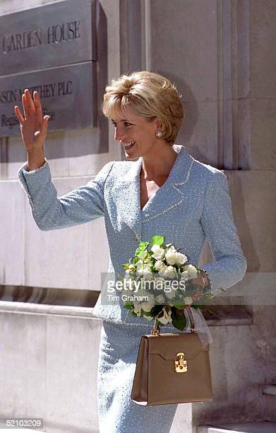 Diana Princess Of Wales Leaving The British Lung Foundation In Hatton Garden After Being Presented With A Bouquet Of The First Rose Named After Her...