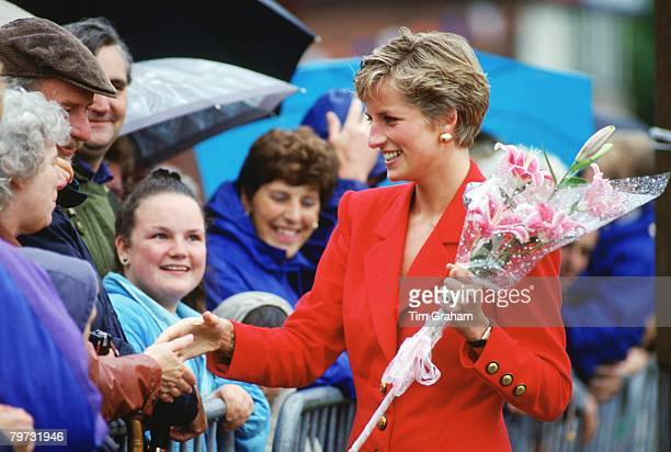 Diana Princess of Wales meets wellwishers on a rainy day during a visit to Blackpool