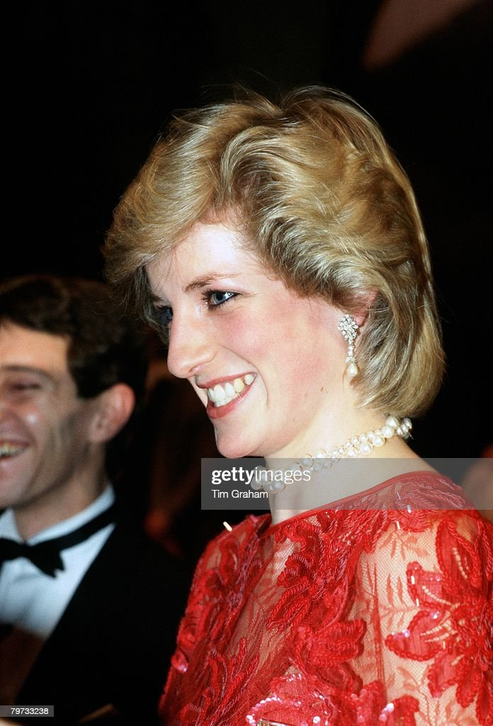 Diana, Princess of Wales on a visit to the ballet in Oslo wearing a red silk taffeta evening dress designed by fashion designer Jan Van Velden