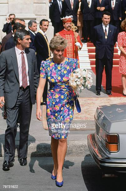 Diana Princess of Wales outside the Town Hall in Seville with bodyguard Colin Trimming She is wearing a dress designed by fashion designers Bellville...