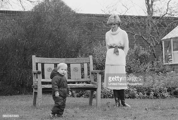 Diana Princess of Wales pictured with her son Prince William during his first press photo call in the garden at Kensington Palace in London on 14th...