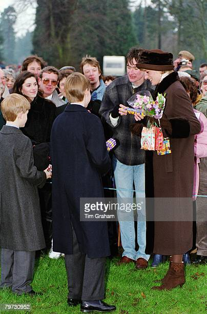 Diana Princess of Wales Prince William and Prince Harry meeting a crowd of wellwishers after attending Christmas Day Service at Sandringham