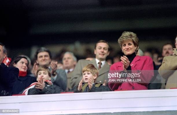 Diana Princess of Wales Princes William and Harry applaud during the Wales vs France Five Nations Cup match at Cardiff Arms Park on February 1 1992 /...