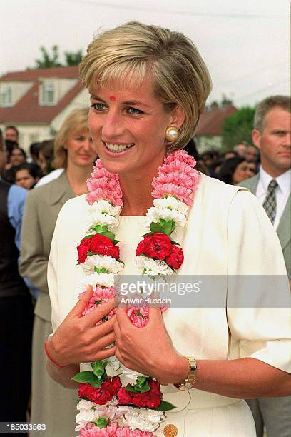 Diana Princess of Wales receives a traditional garland as she arrives at the Shri Swaminarayan Mandir Hindu Temple on June 06 1997 in Neasden London...