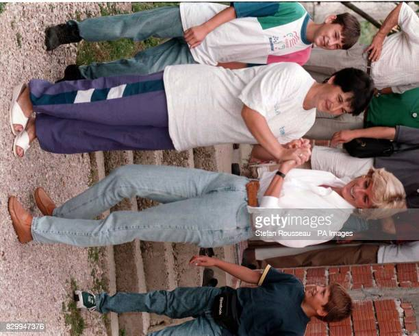 Diana Princess of Wales says goodbye to Nevresa Bradoric at her home near Tuzla this morning on the second day of her two day trip to visit landmine...