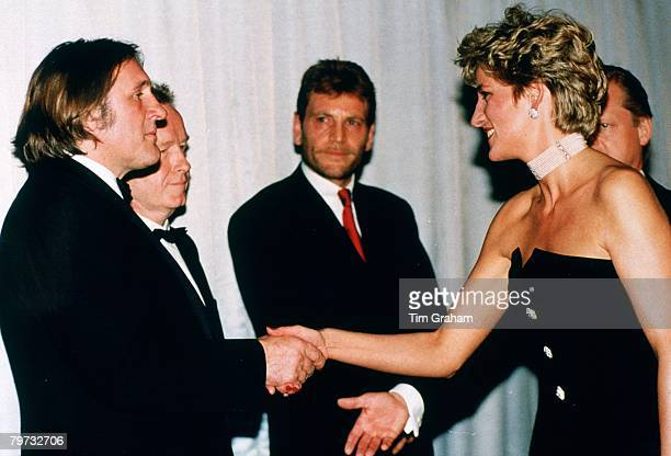 Diana Princess of Wales shakes hands with actor Gerard Depardieu at the Royal Film Premiere of '1492' at the Odeon Leicester Square