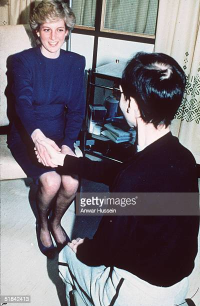Diana Princess of Wales shakes hands with an Aids victim as she opens a new Aids ward at the Middlesex Hospital in this April 9 1987 file photo in...