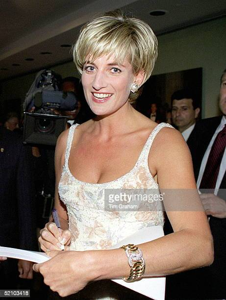 Diana Princess Of Wales Signing A Copy Of The Dresses Auction Catalogue At The Party At Christie's In New York To Launch The Dresses Auction