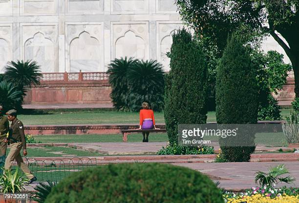 Diana Princess of Wales sits alone during a visit to the Taj Mahal in India